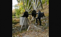 Fabricated from stainless and powdercoated steel, this 8-ton, 36-ft.-tall, at-scale partial replica of the original Boring Mill waterwheel sits on the foundation of the original.