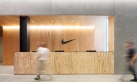 The reception desk at Nike NYHQ has an aura of a shoebox: It's simple, woody and rectangular with an unmistakably simple brand mark.