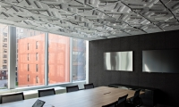 Acoustic ceiling tiles deployed in various meeting rooms echo the tactility of the theme walls.