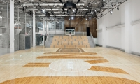 "The wood was stained to complement the floor of the court, which reads in huge letters rather fittingly, ""NYC."""