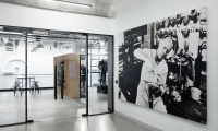 Oversized black and white photography is showcased throughout the space, telling a story about the personalities that have shaped the brand.