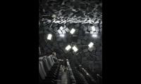 Inside the auditorium, cube-like gray acoustical forms mimic concrete rubble strewn about.