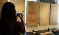 A tour participant snapping a photo at the Gates Foundation.