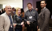 Conference goers at the President's Reception, sponsored by iZone Imaging.