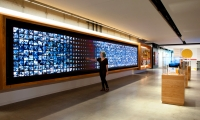 Hamburger University houses a 30-foot interactive touch display with motion-sensed attractor content and multiple educational activities such as interactive timelines and video archives