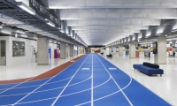The color-coded track augments a simple wayfinding system.