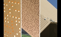 Double layers of perforated MDF cast shadows that form letters on the ground under the shelter.