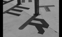 Bevin reproduced parts of the letterforms on the ground near existing bollards.