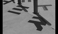 Much as a sundial works, the bollards served as gnomons (shadow-casting objects), completing the letterforms.