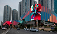 has the longest media facade in the world, at 1,160 feet. Directed by Standard Vision, it displays generative art interspersed with advertising. (Photos: The Creators Project)