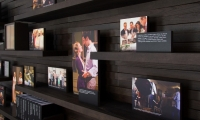 The wall uses digital prints, artifacts and a modular peg mounting system that allows Writers to add new pieces easily.