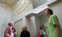 MeCo visitors were captivated by the unusual use of a hotel room space. Fujita's installation featured suspended origami artifacts and abstracted moving imagery projected on the walls, ceiling, and bathroom surfaces, coordinated with live performances.