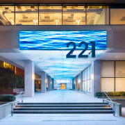 At 221 Main Street, ESI Design created a 126 foot-long digital display—a medium for locally-inspired content— that extends from the exterior façade to the interior lobby.