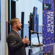 Conference participants attending NEXPO Talk sessions where Dan Rossborough of NanoLumens presented.