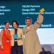 YIEUM Partners accepting the Sylvia Harris Award for Skyline Wayfinding.