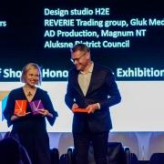 Design studio H2E accepting the Best of Show award for Aluksne Banitis Station.