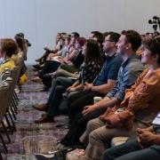 Conference audience listening to Paula Scher, Pentagram and SEGD Fellow, speak.