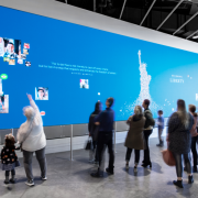 "Visitors consider their own roles in liberty's future by adding their self-portrait and collage of inspirational images to the ""Becoming Liberty"" digital mural—the emotional peak of the experience. (KEENA Photo)"