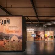 "Farm-inspired materials and real-world tools help authenticate the ""On the farm"" experience with honest storytelling and hands-on exhibits."