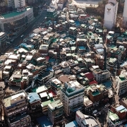 Geumho-dong, a hilltop pocket of older residential houses as a singular cluster without roads. (image: crowded overhead view of neighborhood)