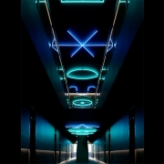 Dimly lit guest corridors are illumined by lighting installations and wayfinding representing alchemical formulas and astrological constellations (image: geometric lights on ceiling)