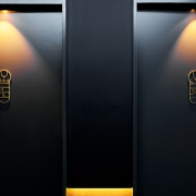 Alchemical symbols and elements are integrated into guest room numbers. (image: corridor room signage)