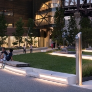 Cornell Tech (image: campus landscaping by night with lit column)