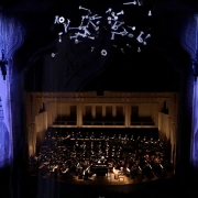 Photo taken from upper balcony during live performance.(image: colorful projections in theater)