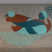 "Mural features the Cinnamon Ducks of elewexe (Paso Robles) and the graphic pattern element represents the Salinas River ""highway"""