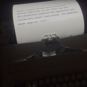 A summary of each author appears on printed page before he/she begins talking. Visitor immediately introduced to them, and foreshadow key themes in story that will unfold. (image: projected type on typewriter)