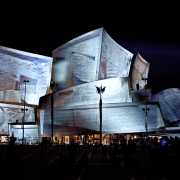 Still image taken during the performance of an output of the GAN algorithm. (image: design projected on concert hall exterior)