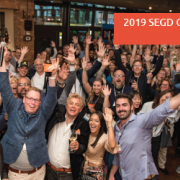 photo is from  the 2018 SEGD Conference Experience Minneapolis where everyone has their hands up and are having a good time.
