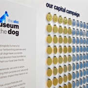Donor recognition was important to the AKC. (image: donor wall with dog tags)