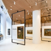 Seven pivoting black steel art display walls can be rotated for different exhibits and accommodate larger events. (image: steel framed walls)