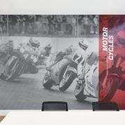 There were distinct events that stood out as critical to address—the Formula 1 retrofit and motocross, truck and drag racing as part of the local culture. (image: supergraphic of motorcycle)