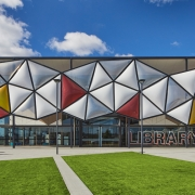 The brand-new Oran Park Library, designed by architects Brewster Hjorth in collaboration with Camden Council, Greenfields Development Company, Landcom and ADCO Constructions sits at the center of Oran Park Town. (image: building facade)