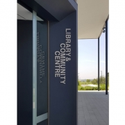 """The Library serves as a convenient gathering space for the burgeoning development, right next to the new offices of the council government. (image: """"community center"""" signage)"""