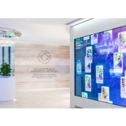 Visitors come off the street into a reception area with colorful LED curtain.