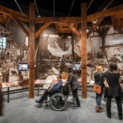 Stepping through an archway of solid wood scaffolding, visitors discover Constructing Liberty, and have the chance to step into the Paris workshop where Bartholdi directed craftsmen to transform his design models into the final Statue. (Keena Photo)