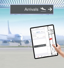 SignAgent Launches Mobile App (image: hand holds iPad while plane takes off)