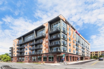 Ware Malcomb Announces Yale 25 Station Apartments Complete (image: photo of apartment building)