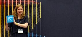Photograph of Jill Ayers holding an SEGD Design Award