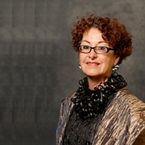 Nora Olgyay, Associate Professor