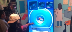 All Paws on Deck for Dogs! at LA's California Science Center (image: girl uses interactive exhibit)