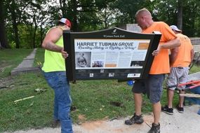Signs honoring Harriet Tubman installed in Wyman Park Dell, where Confederate statues once stood