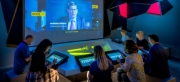 Exhibition Espionage—G&A at the All New International Spy Museum (image: visitors interact with game experience)