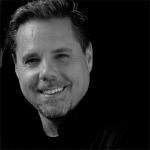 Headshot of Doug Morris, Partner in Poulin + Morris