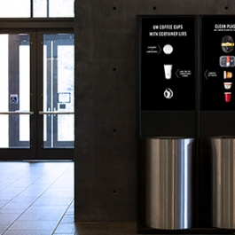 An interactive waste system with three receptacles (for compost, recycle and landfill) each of which is connected to a digital scale, microcomputer and digital screen.