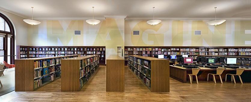 """Whitehouse and Company Banner - library with work """"imagine"""" on wall"""